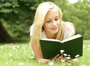 bigstock-Young-beautiful-girl-reading-a-14450870